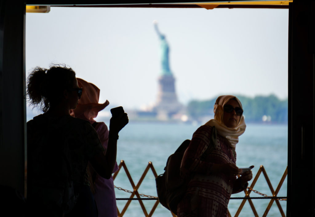 Tourists on the SI Ferry statue of liberty